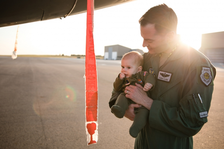father and son on a military flightline in flightsuits
