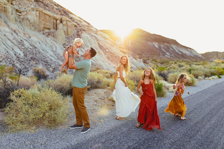 family of five having a dance party in red rocks