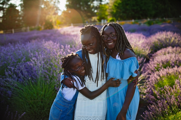 three sisters in a field of lavender