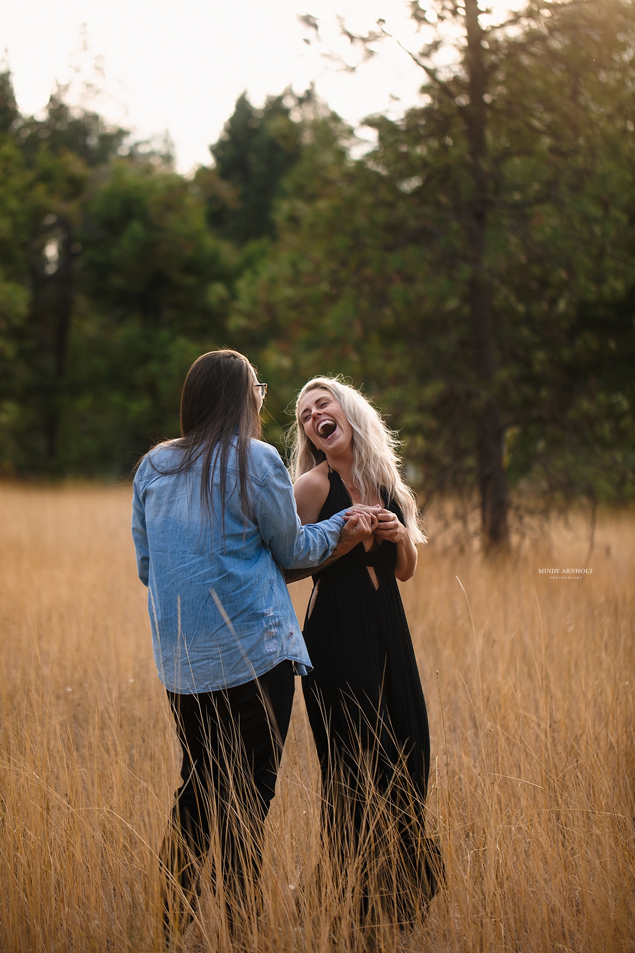 LGBTQ Couples session - Cute lesbian couple dancing in a field - Spokane Couple's Photographer
